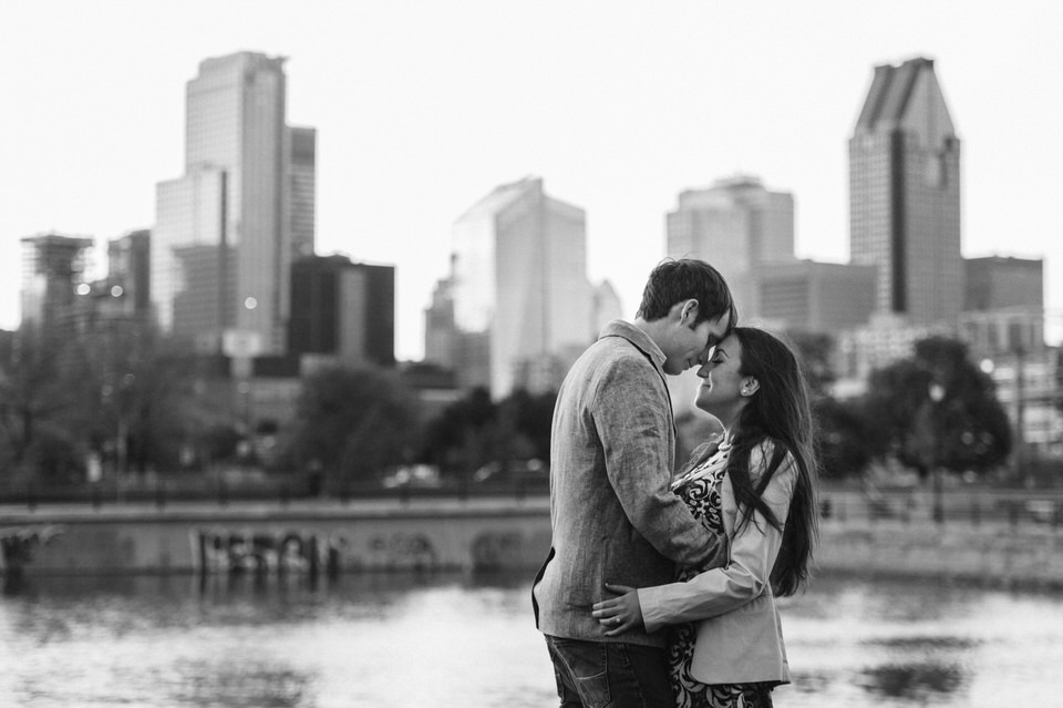 Engagement photo with skyline of downtown Montreal