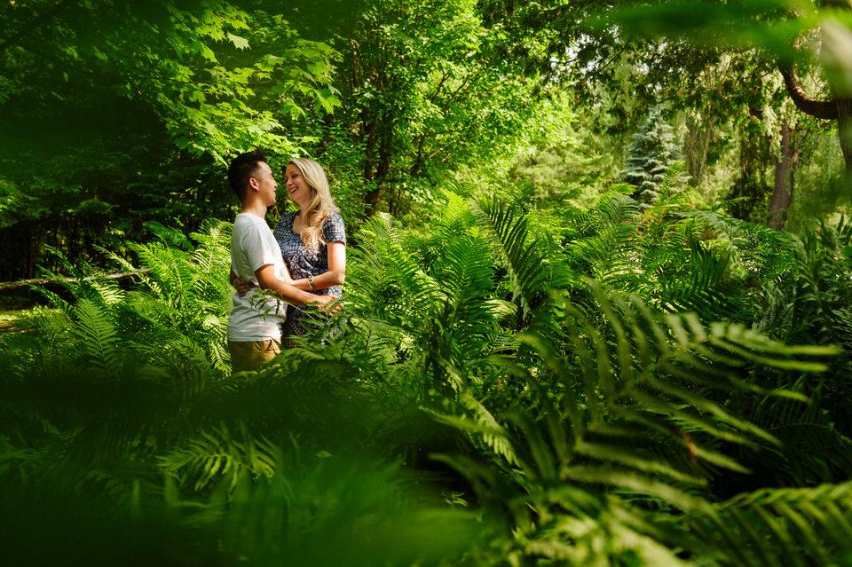 Engagement portrait among the ferns