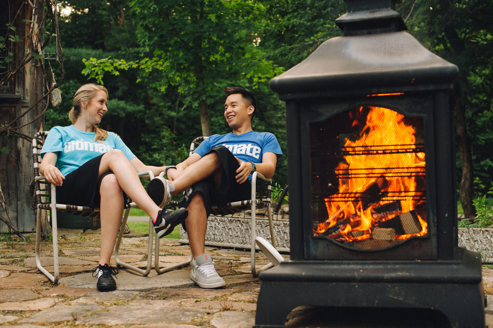 Backyard engagement shoot with fireplace and lawnchairs