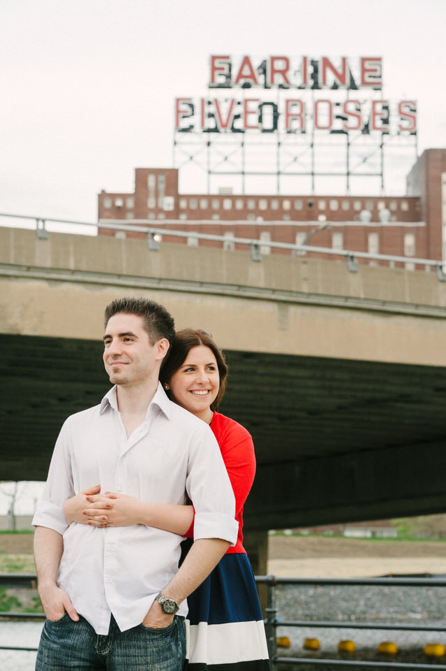 Cute engaged couple in front of Farine Five Roses sign in Montreal