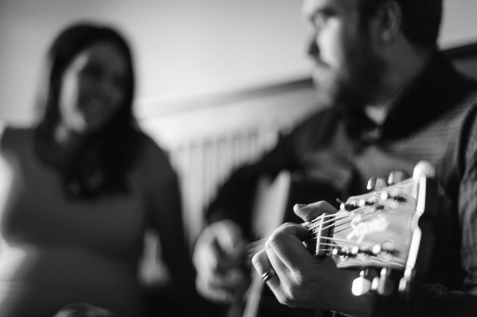 Close up of man's hands playing guitar for wife