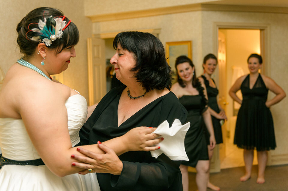 Mother of bride hugging her with emotion