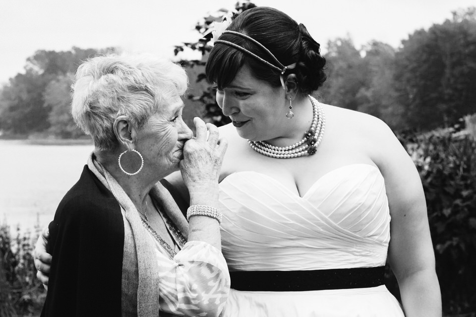 Emotional grandmother talking to bride