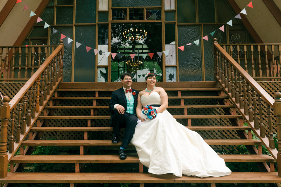 Wedding couple sitting on porch steps of chapel at Hotel Trois Tilleuls
