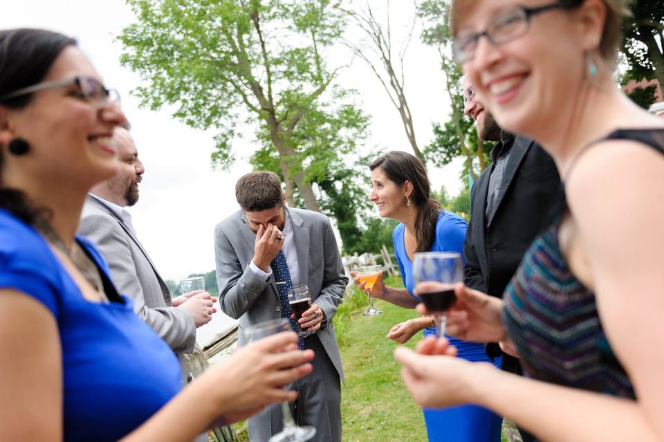 Wedding guests laughing and drinking