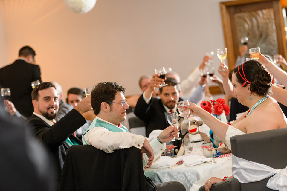Guests raising glasses for toast