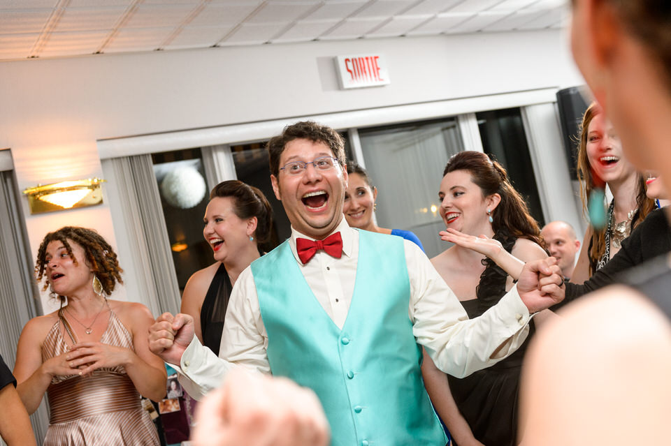 Groom dancing surrounded by women