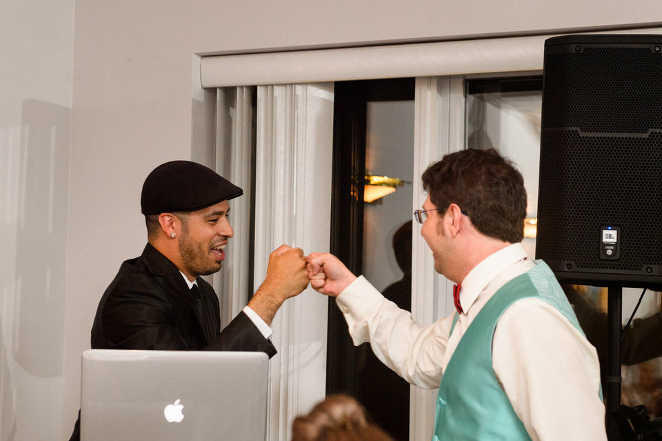 Groom giving a fist bump to DJ