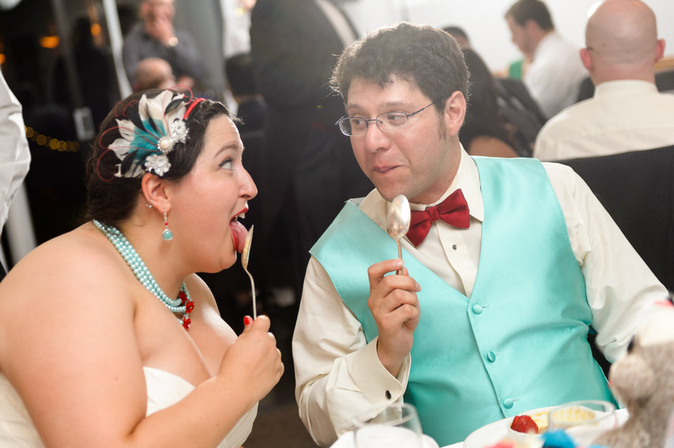 Bride and groom licking their ice cream spoons
