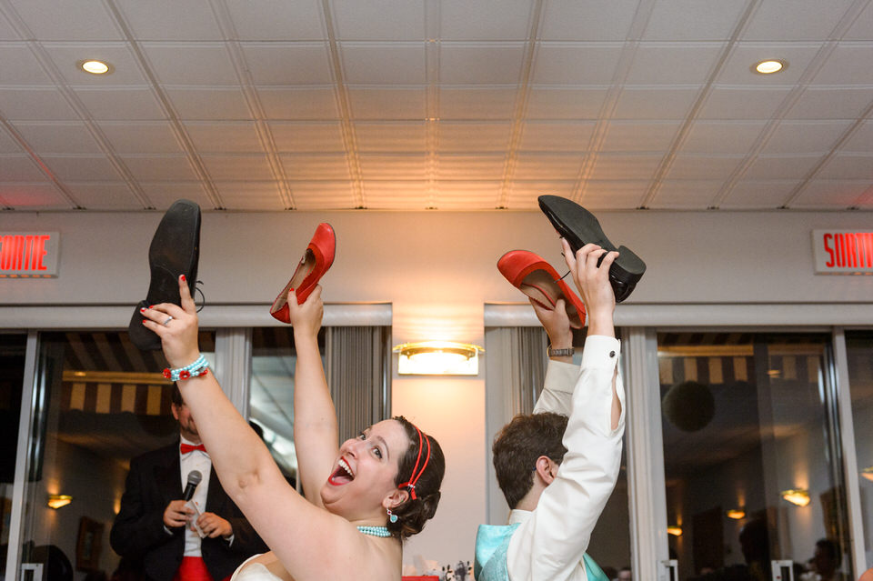 Bride and groom playing the shoe game at wedding reception