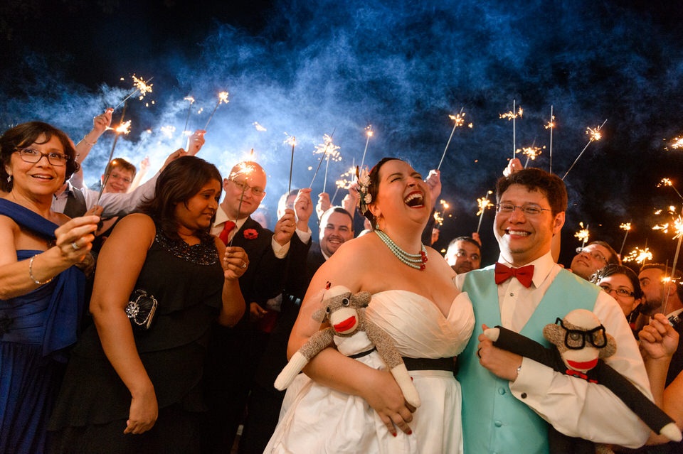 Group photo with sparklers and wedding guests