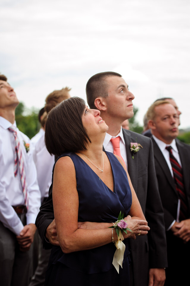 Bride's mom and brother emotional as they watch the balloons rise