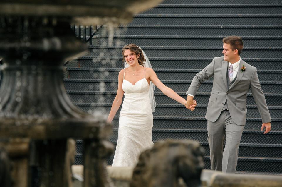 Emotional entrance of bride and groom holding hands