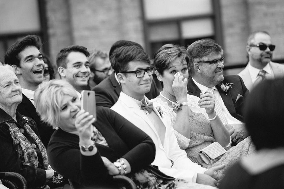 Family and guests emotional at wedding ceremony