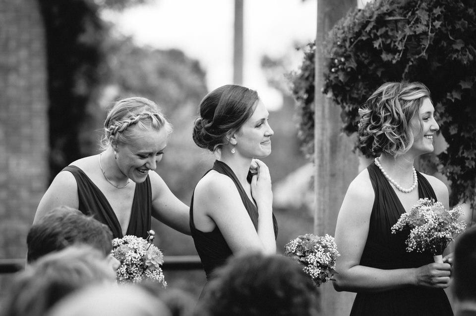 Emotional bridesmaids holding hands