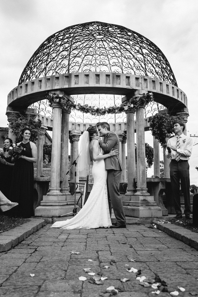 First kiss as married couple in front of gazebo