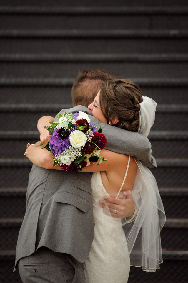 Wedding couple hugging after they just got married