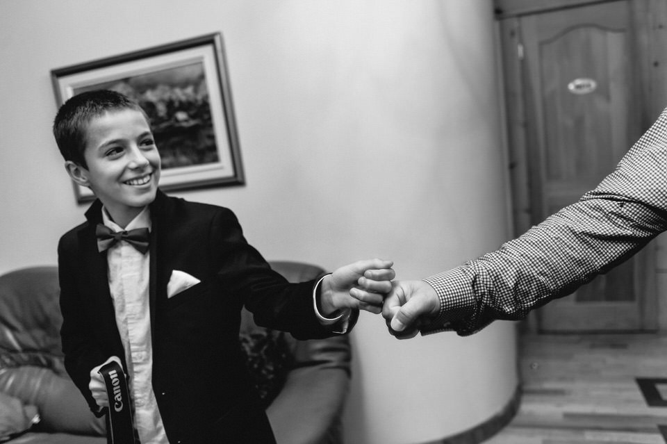 Fist bump to kid at wedding