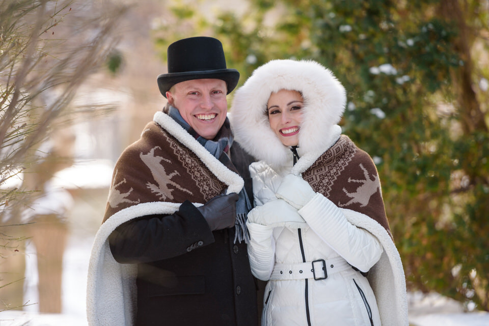 Winter wedding portraits with blanket outdoors