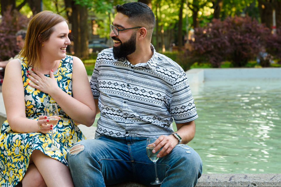 Woman with hand on heart looking at her new fiancé