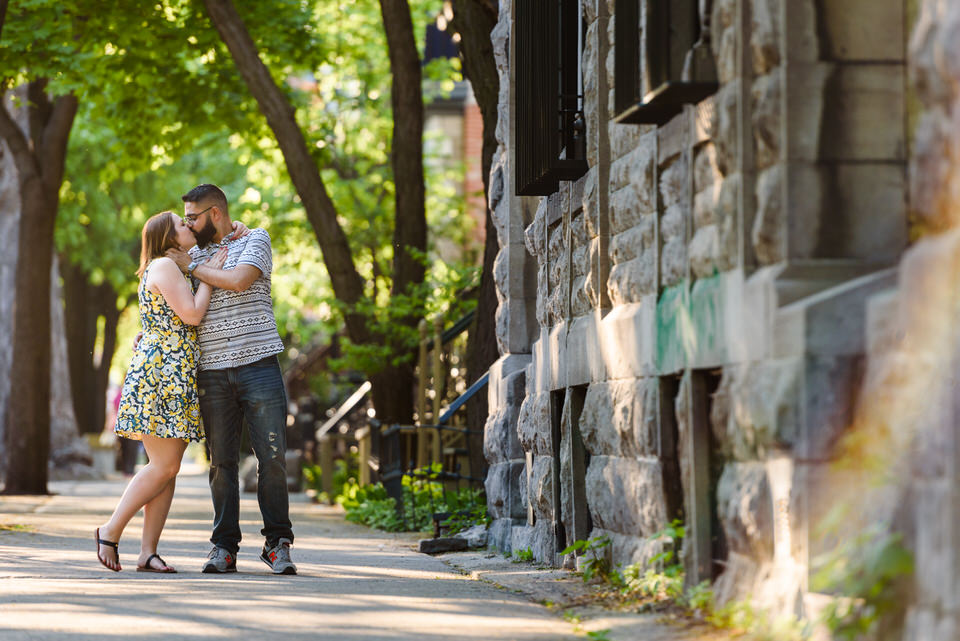 Couple kissing on the sidewalk in Montreal