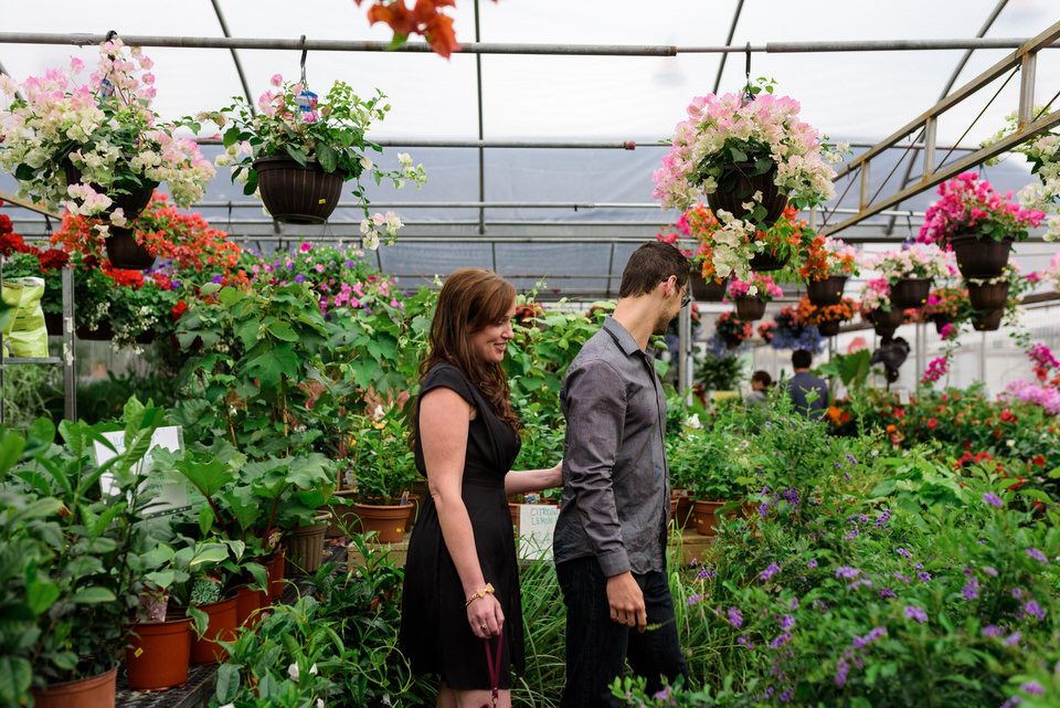 Couple wandering through greenhouse at Atwater Market