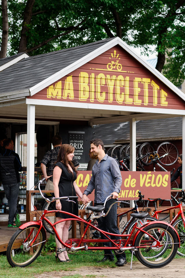 Couple standing in front of Ma Bicyclette bike rental shop