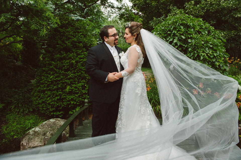 edding veil blowing in the wind during bridal portrait