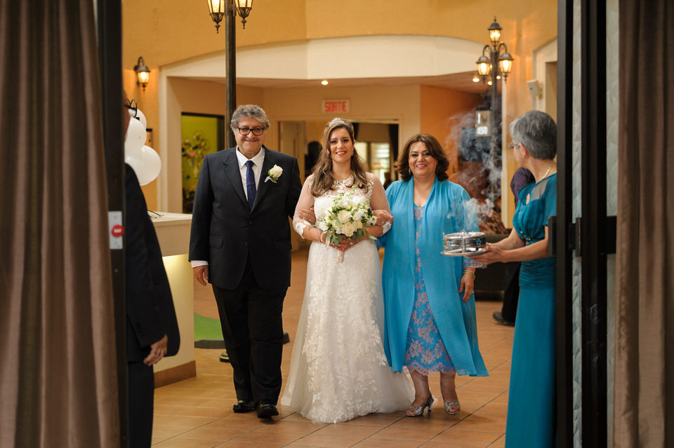 Bride and parents arriving at wedding ceremony