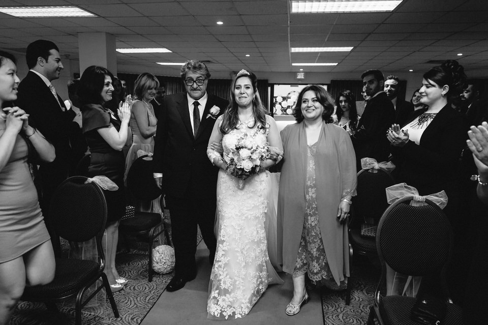 Emotional bride arriving with parents