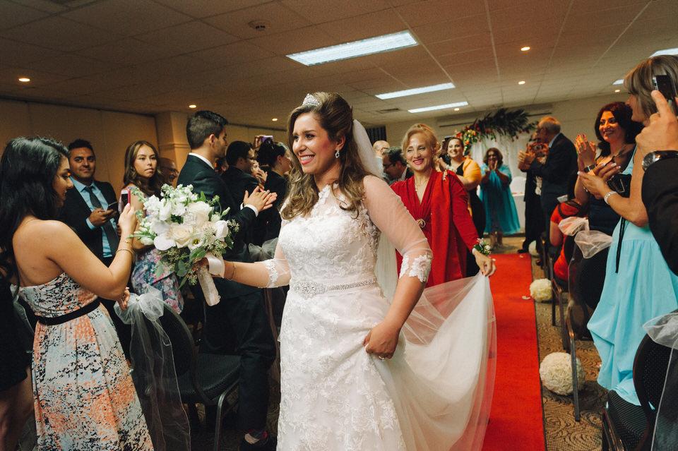 Bride dancing during Persian wedding ceremony