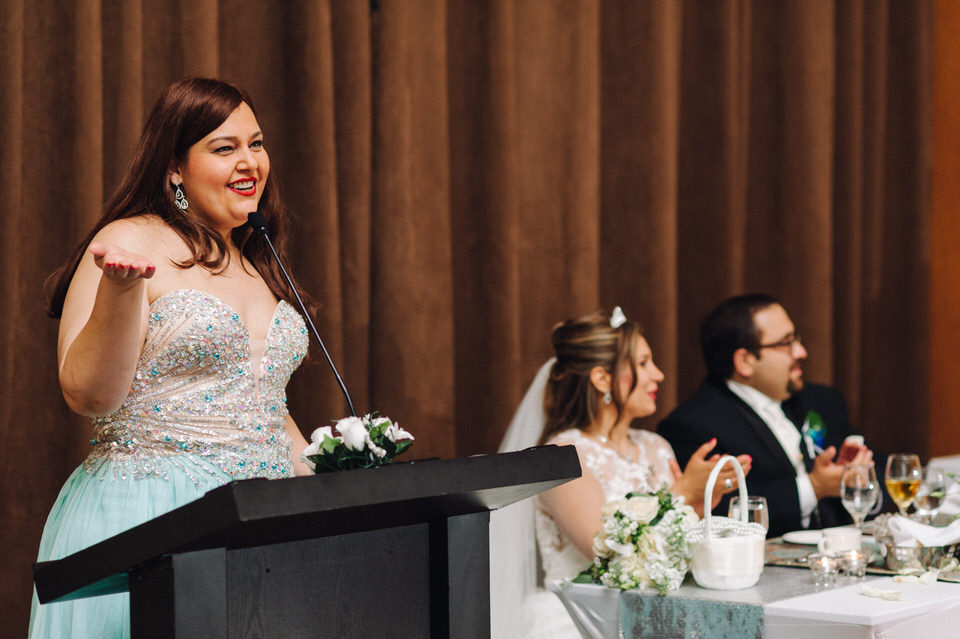 Maid of honour giving a speech at the wedding reception