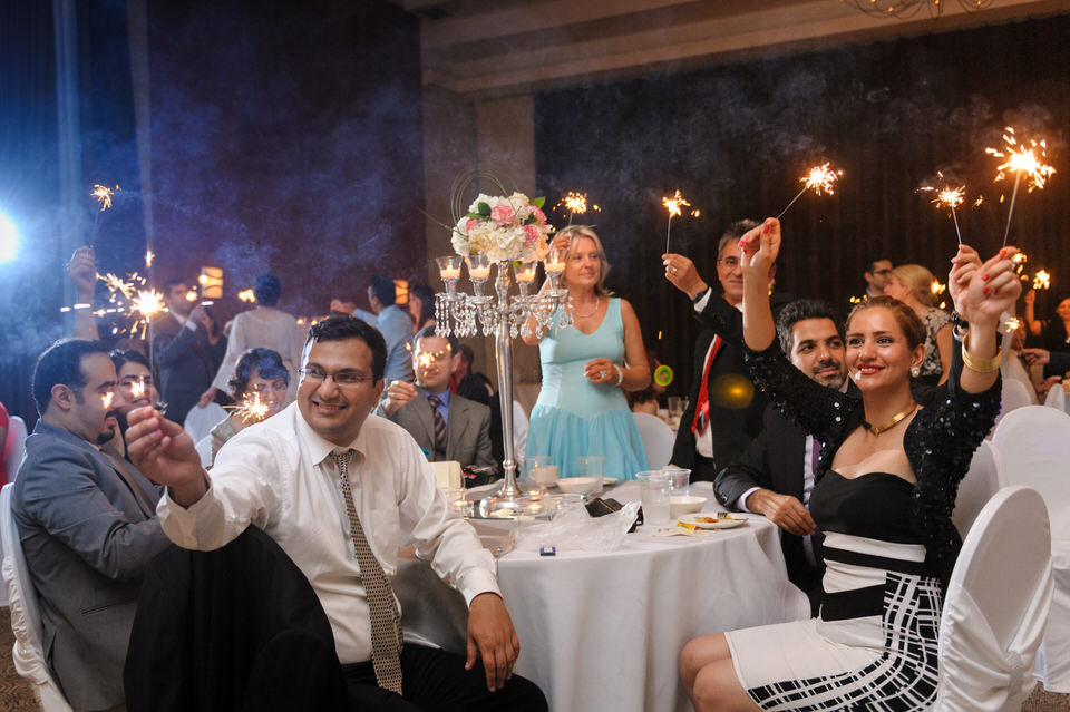 Guests holding sparklers during first dance