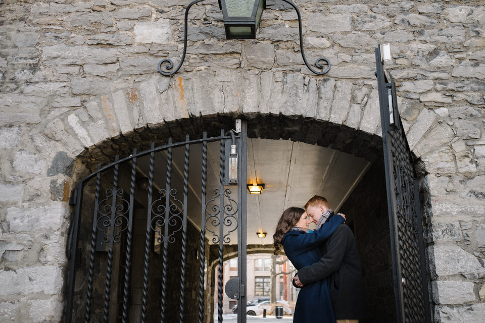 Engaged couple kissing in gateway