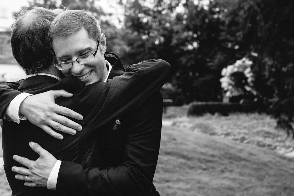 Groom hugging his friend