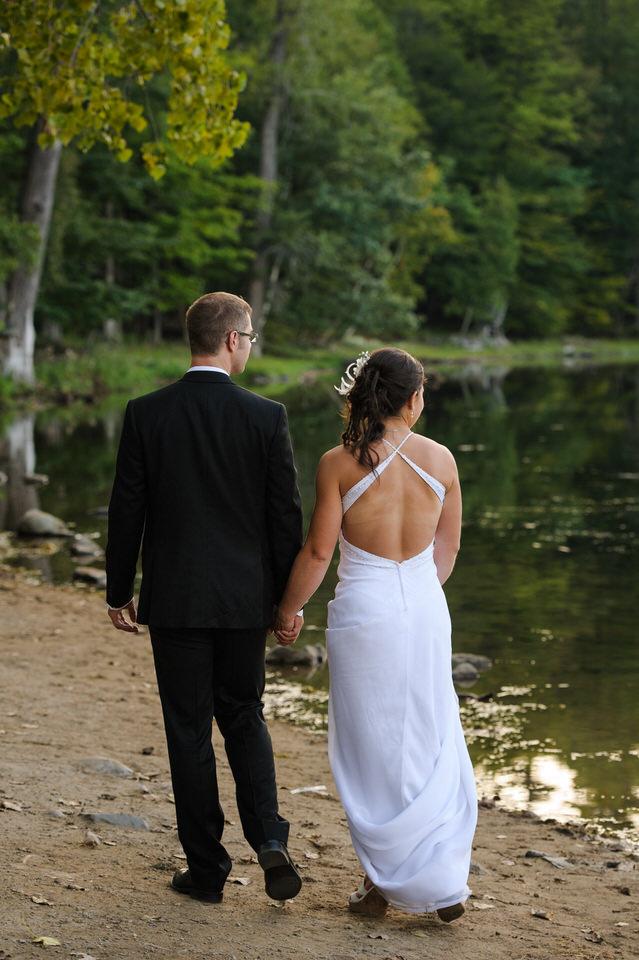 Wedding couple walking along the lake side
