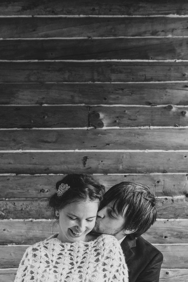 Rustic wedding photo with log cabin