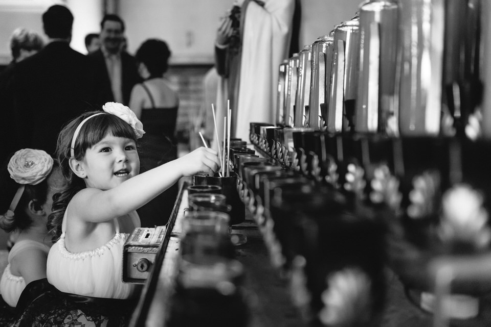 Child playing with candles at Catholic church