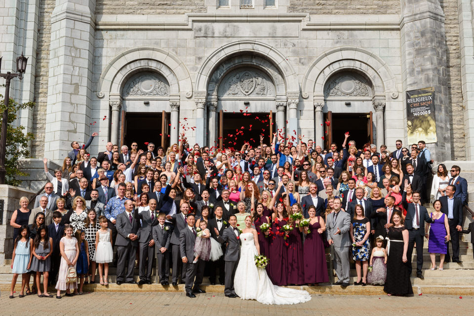 Big group photo with wedding guests on the steps of the Saint-Anges church in Lachine
