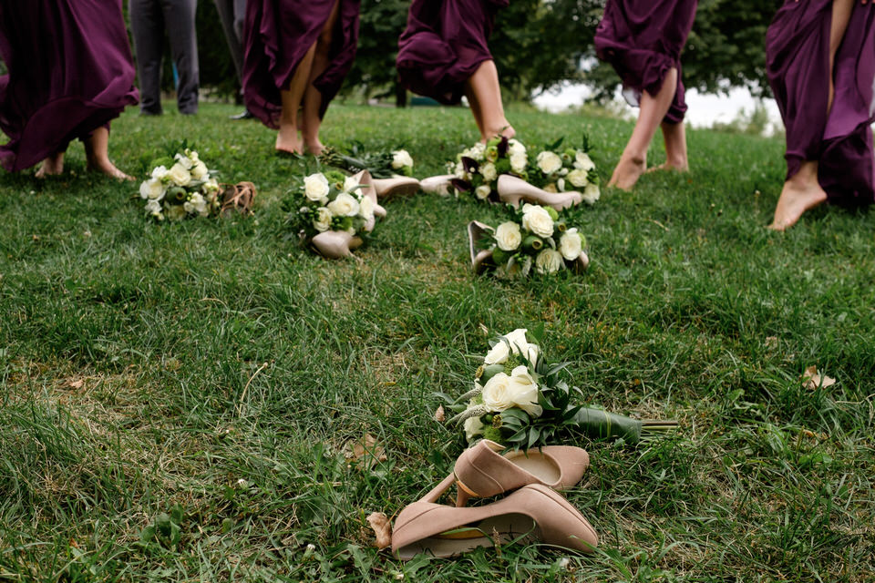 Bridesmaids shoes lying in the grass