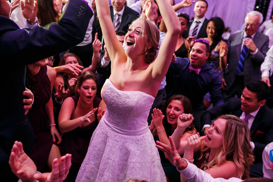 Bride dancing with friends around her