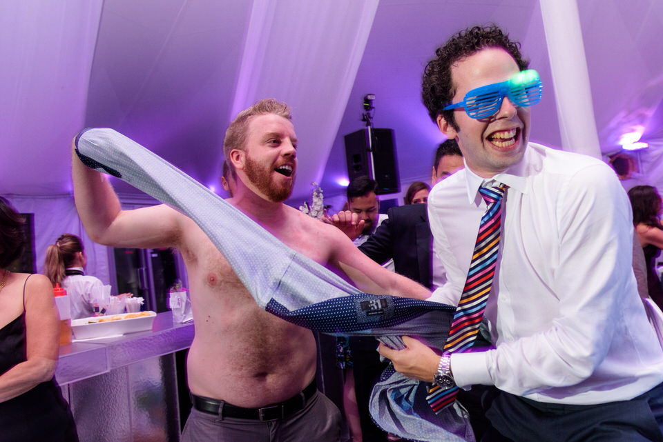 Man taking off his shirt for wedding game