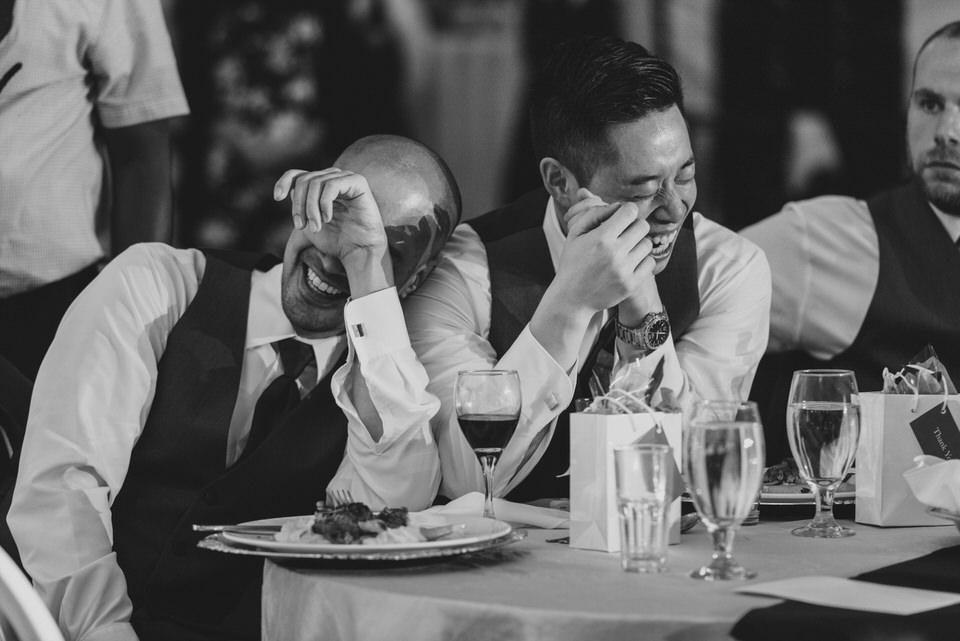 Groomsmen laughing at speech