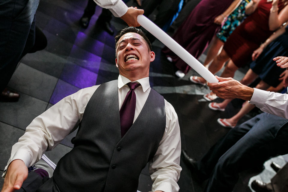 Man doing the limbo at wedding reception