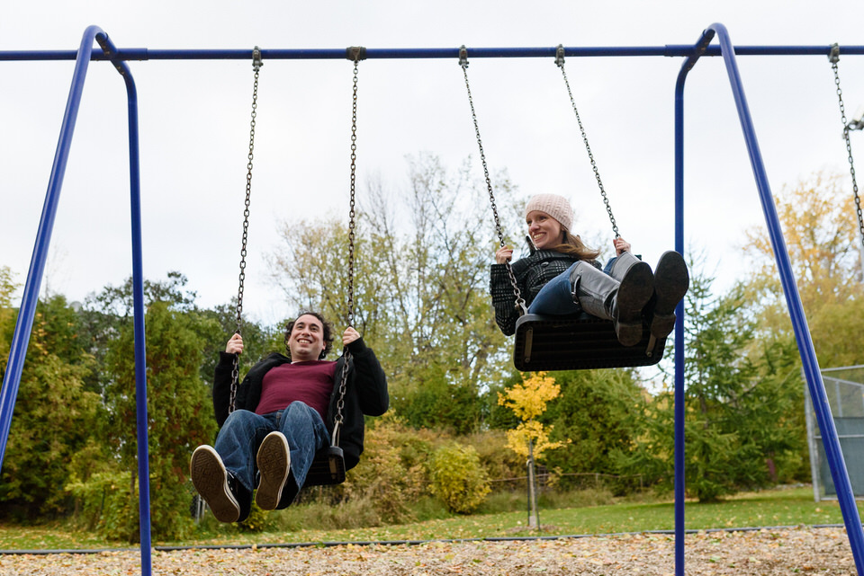 couple swinging on a swing