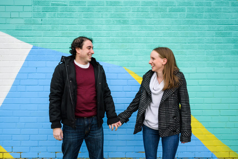 Couple holding smiling to each other
