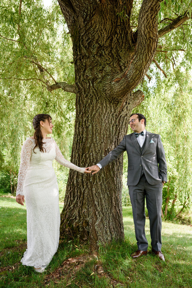 Wedding couple seeing each other for the first time under a willow tree