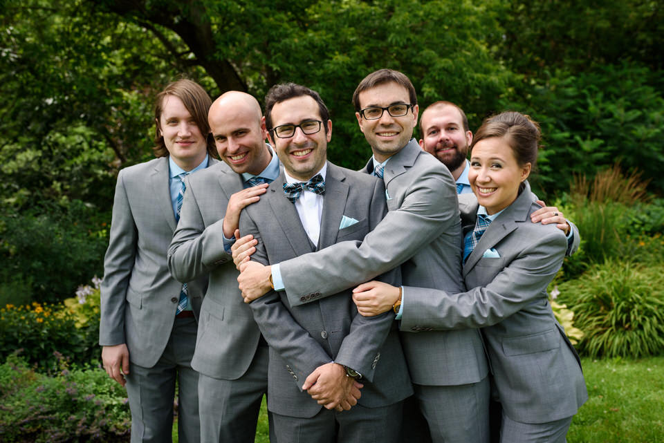 Groom being hugged by his friends