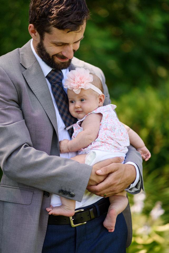 Man holding baby flower girl