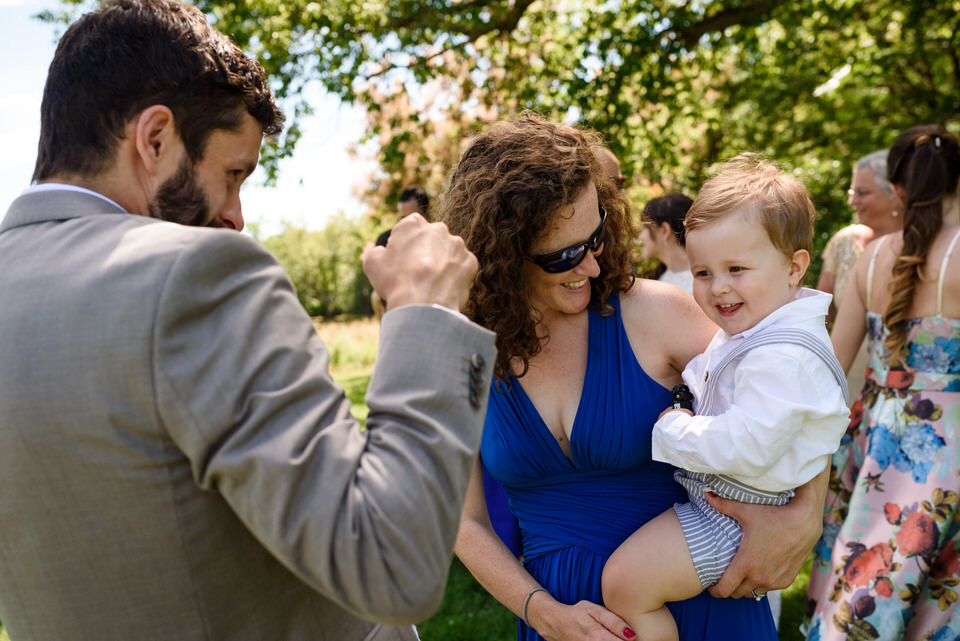 Ring bearer in his mom's arms